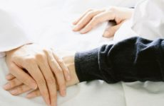 Medical doctor holding patient's hands and comforting her with care, Doctor supports her palliative patient with sympathy. (Selective Focus)